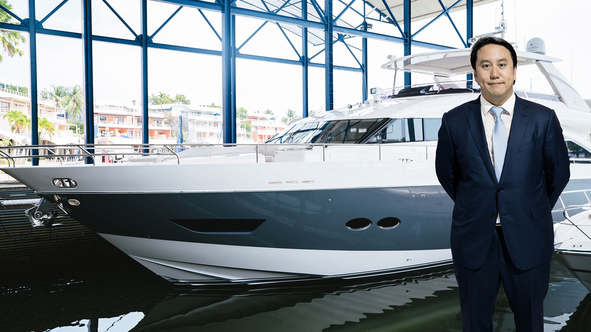 Mr. Vrit Yongsakul, Managing Director of Boat Lagoon Yachting Co., Ltd., is photographed with a Princess yacht.